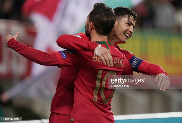 Cristiano Ronaldo of Portugal and Juventus celebrates with teammate Bernardo Silva of Portugal and Manchester City after scoring a goal during the...