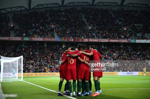 Cristiano Ronaldo of Portugal and Juventus celebrates with teammates after scoring a goal during the UEFA Euro 2020 Qualifier match between Portugal...