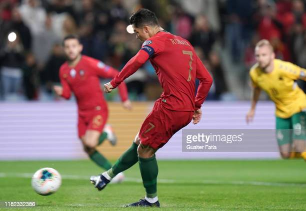 Cristiano Ronaldo of Portugal and Juventus scores goal from a penalty shot during the UEFA Euro 2020 Qualifier match between Portugal and Lithuania...