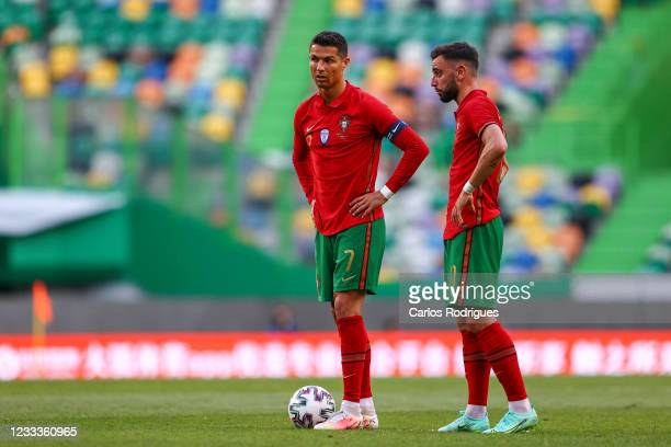 Cristiano Ronaldo of Portugal and Juventus talks Bruno Fernandes of Portugal and Manchester United in action during the international friendly match...