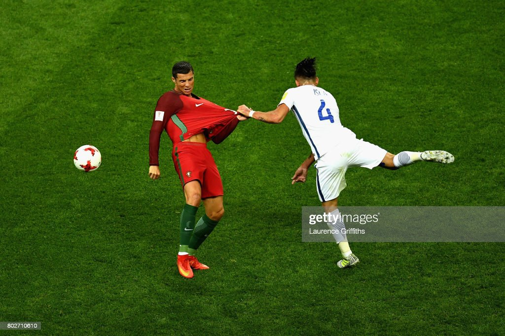 Cristiano Ronaldo of Portugal and Mauricio Isla of Chile battle for possession during the FIFA Confederations Cup Russia 2017 Semi-Final between Portugal and Chile at Kazan Arena on June 28, 2017 in Kazan, Russia.