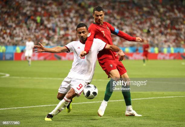 Cristiano Ronaldo of Portugal and Omid Ebrahimi of Iran compete for the ball during the 2018 FIFA World Cup Russia group B match between Iran and...