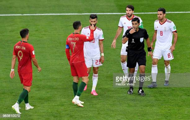 Cristiano Ronaldo of Portugal and Ramin Rezaeian of Iran argue with refere Enrique Caceres during the 2018 FIFA World Cup Russia group B match...