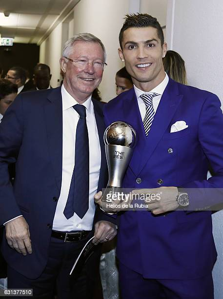 Cristiano Ronaldo of Portugal and Real Madid and Alex Ferguson ex headcocah Manchester United pose with his The Best FIFA Men's Player Award after...