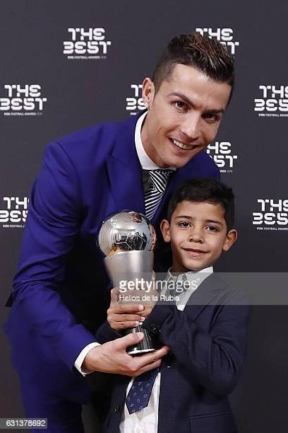 Cristiano Ronaldo of Portugal and Real Madid and his son pose with his The Best FIFA Men's Player Award after The Best FIFA Football Awards at TPC...