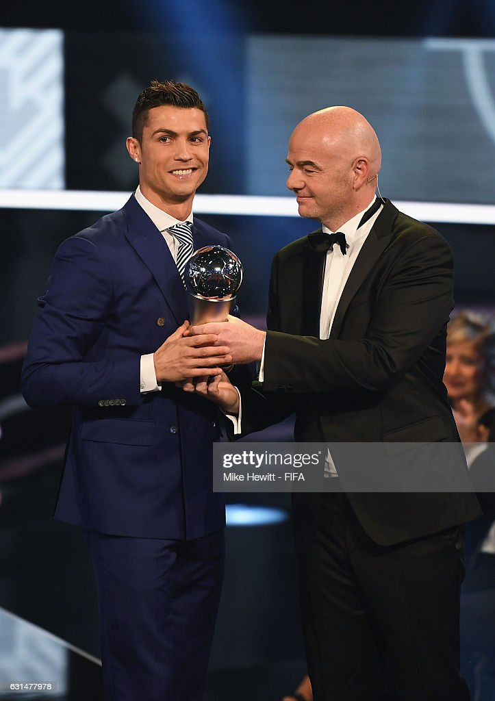 Cristiano Ronaldo of Portugal and Real Madrid accepts The Best FIFA Men's Player Award from FIFA President Gianni Infantino during The Best FIFA Football Awards at TPC Studio on January 9, 2017 in Zurich, Switzerland.