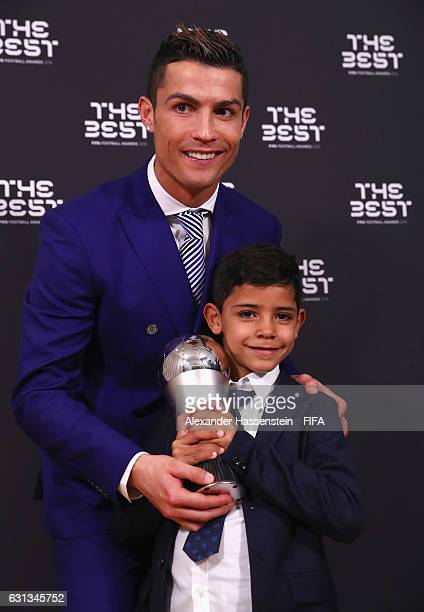 Cristiano Ronaldo of Portugal and Real Madrid and his son Ronaldo Junior pose with The Best FIFA Men's Player Award during The Best FIFA Football...