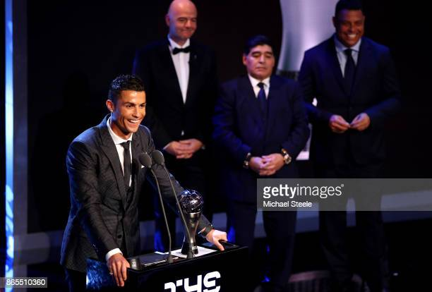 Cristiano Ronaldo of Portugal and Real Madrid CF wins The best Fifa men's player as Diego Maradona Gianni Infantino and Ronaldo look on during The...