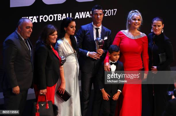Cristiano Ronaldo of Portugal and Real Madrid CF wins The best Fifa men's player and celebrates on stage with Georgina Rodriguez and Cristiano...