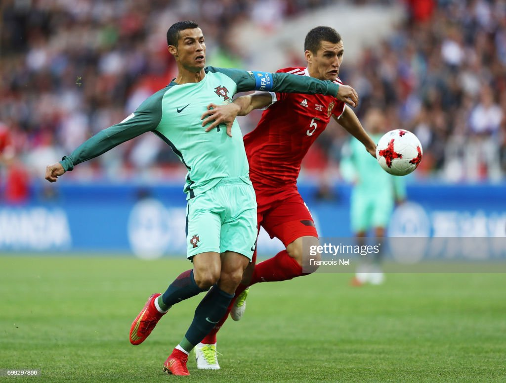 Cristiano Ronaldo of Portugal and Viktor Vasin of Russia battle for possession during the FIFA Confederations Cup Russia 2017 Group A match between Russia and Portugal at Spartak Stadium on June 21, 2017 in Moscow, Russia.