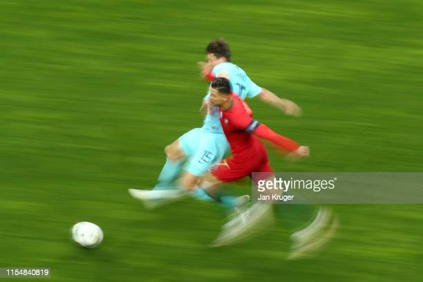 Cristiano Ronaldo of Portugal battles for possession with Marten de Roon of the Netherlands during the UEFA Nations League Final between Portugal and...