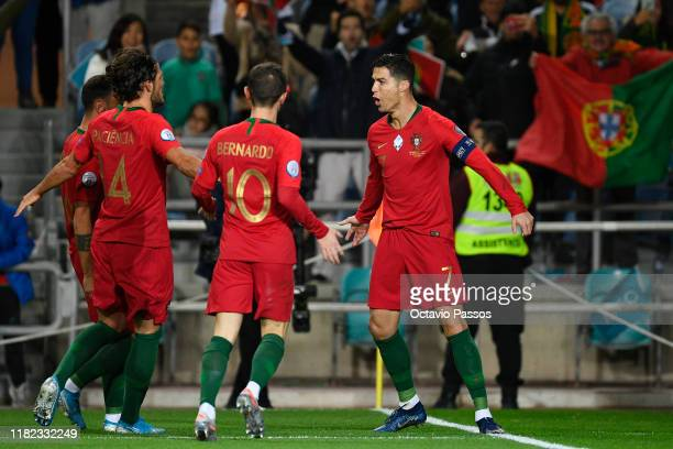 Cristiano Ronaldo of Portugal celebrates after scores the first goal against Lithuania during the UEFA Euro 2020 Qualifier match between Portugal and...
