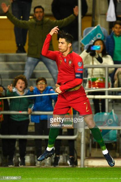 Cristiano Ronaldo of Portugal celebrates after scores the second goal against Lithuania during the UEFA Euro 2020 Qualifier match between Portugal...