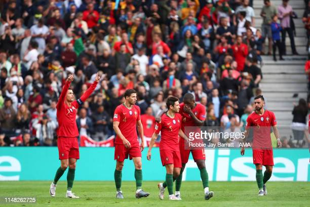 Cristiano Ronaldo of Portugal celebrates after scoring a goal to make it 1-0 from a free kick during the UEFA Nations League Semi-Final match between...
