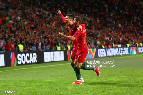 Cristiano Ronaldo of Portugal celebrates after scoring a goal to make it 2-0 with Bernardo Silva during the UEFA Nations League Semi-Final match...