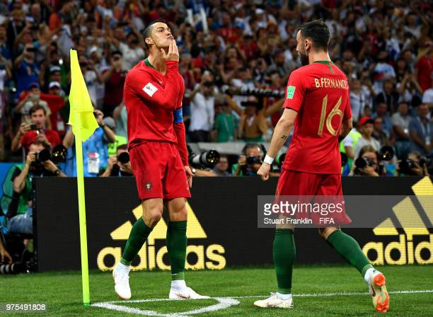 Cristiano Ronaldo of Portugal celebrates after scoring a penalty for his team's first goal during the 2018 FIFA World Cup Russia group B match...
