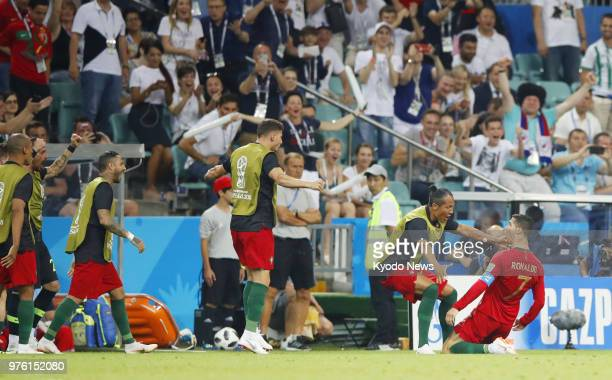 Cristiano Ronaldo of Portugal celebrates after scoring his side's second goal against Spain in a penalty kick during the first half of a World Cup...