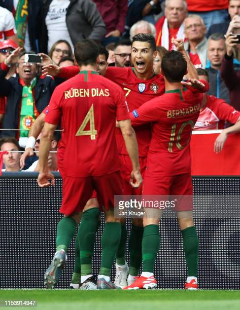 Cristiano Ronaldo of Portugal celebrates after scoring his team's first goal with team mates during the UEFA Nations League SemiFinal match between...
