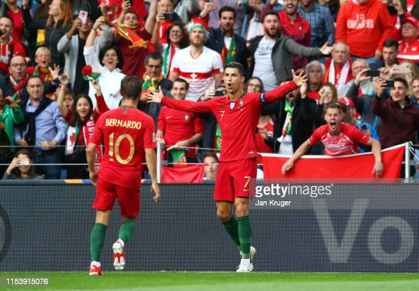 Cristiano Ronaldo of Portugal celebrates after scoring his team's first goal with team mate Bernardo Silva during the UEFA Nations League Semi-Final...
