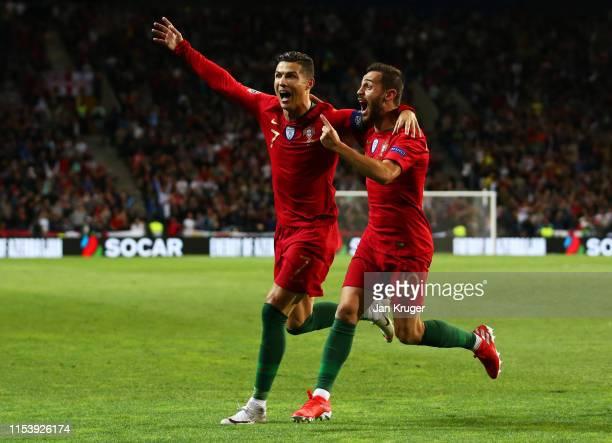 Cristiano Ronaldo of Portugal celebrates after scoring his team's second goal with Bernardo Silva during the UEFA Nations League SemiFinal match...