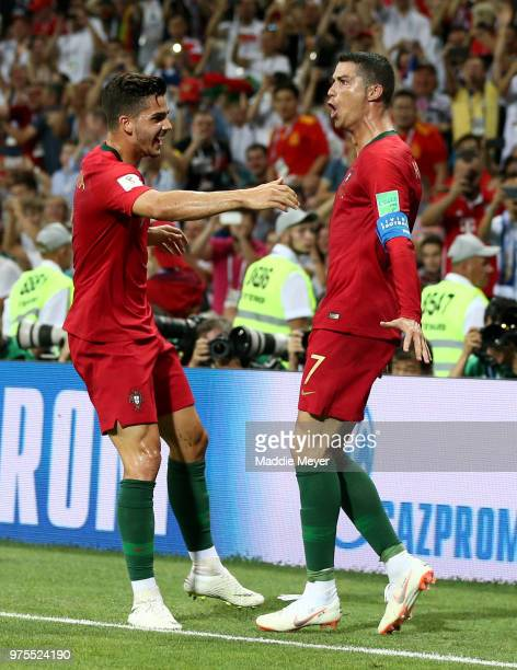 Cristiano Ronaldo of Portugal celebrates after scoring his team's third goal with team mate Andre Silva of Portugal during the 2018 FIFA World Cup...