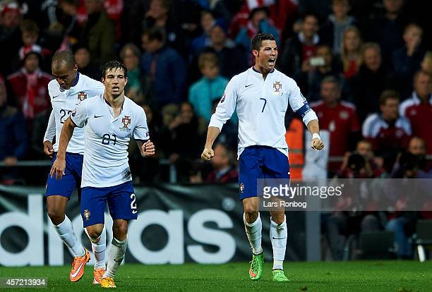 Cristiano Ronaldo of Portugal celebrates after scoring their first goal during the UEFA 2016 Group I Qualifier between Denmark and Portugal at Telia...