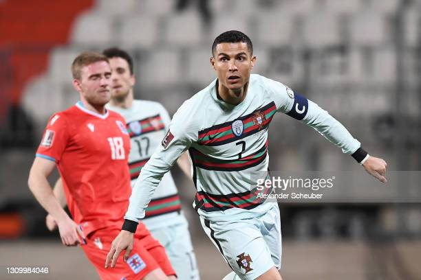 Cristiano Ronaldo of Portugal celebrates after scoring their side's second goal during the FIFA World Cup 2022 Qatar qualifying match between...