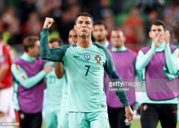Cristiano Ronaldo of Portugal celebrates and thanks for the support of the Portuguese fans after the FIFA 2018 World Cup Qualifier match between...