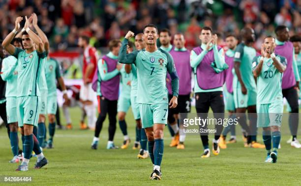 Cristiano Ronaldo of Portugal celebrates and thanks for the support of the Portuguese fans with Andre Silva of Portugal and Ricardo Quaresma of...