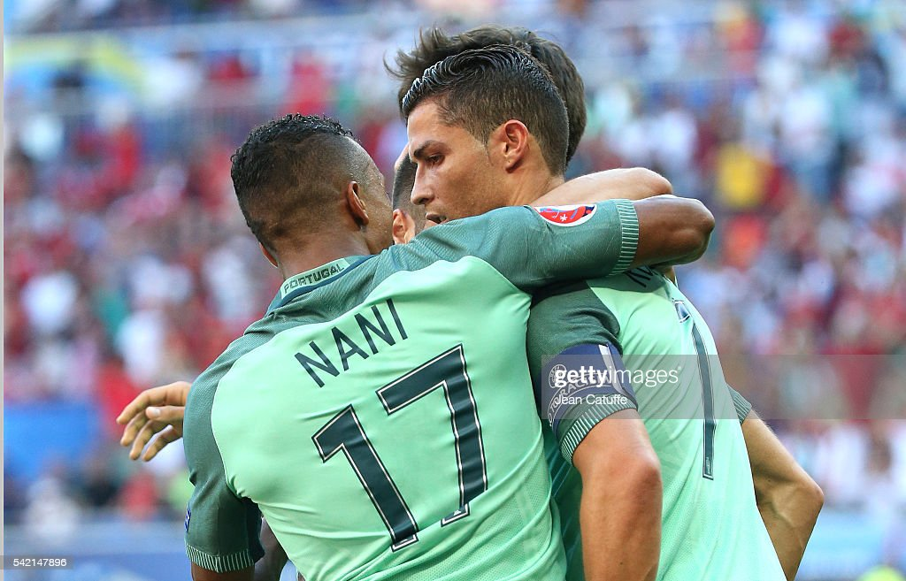 Cristiano Ronaldo of Portugal celebrates his last goal with Nani and teammates during the UEFA EURO 2016 Group F match between Hungary and Portugal at Stade des Lumieres on June 22, 2016 in Lyon, France.