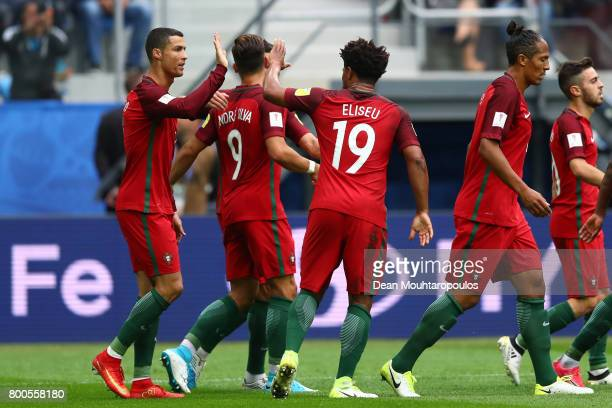 Cristiano Ronaldo of Portugal celebrates scoring his sides first goal with Eliseu of Portugal during the FIFA Confederations Cup Russia 2017 Group A...