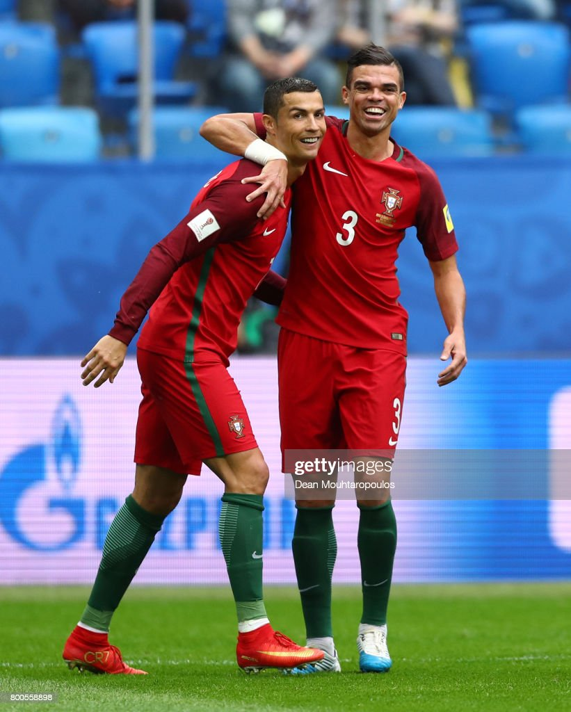 Cristiano Ronaldo of Portugal celebrates scoring his sides first goal with Pepe of Portugal during the FIFA Confederations Cup Russia 2017 Group A match between New Zealand and Portugal at Saint Petersburg Stadium on June 24, 2017 in Saint Petersburg, Russia.