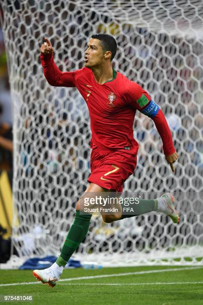 Cristiano Ronaldo of Portugal celebrates scoring his side's first goal, from a penalty, during the 2018 FIFA World Cup Russia group B match between...
