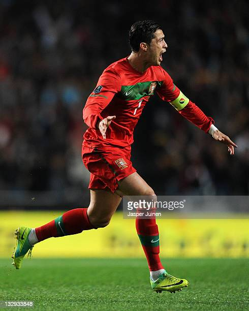 Cristiano Ronaldo of Portugal celebrates scoring his sides opening goal from a free kick during the Portugal and Bosnia EURO 2012 qualifier play off...