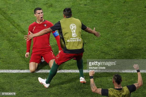 Cristiano Ronaldo of Portugal celebrates scoring his side's second goal with team mate Bruno Alves during the 2018 FIFA World Cup Russia group B...