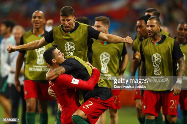 Cristiano Ronaldo of Portugal celebrates scoring his side's second goal with Bruno Alves and team mates during the 2018 FIFA World Cup Russia group B...
