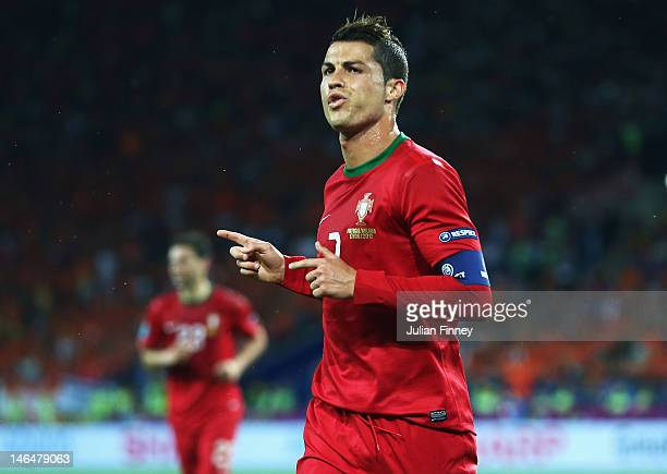 Cristiano Ronaldo of Portugal celebrates scoring his team's first goal during the UEFA EURO 2012 group B match between Portugal and Netherlands at...