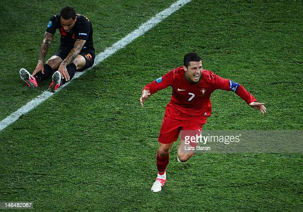 Cristiano Ronaldo of Portugal celebrates scoring his team's second goal as Wilfred Bouma of Netherlands shows his dejection during the UEFA EURO 2012...