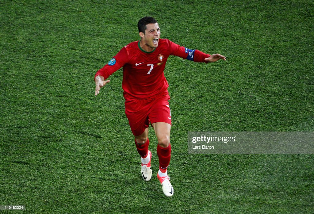 Cristiano Ronaldo of Portugal celebrates scoring his team's second goal during the UEFA EURO 2012 group B match between Portugal and Netherlands at Metalist Stadium on June 17, 2012 in Kharkov, Ukraine.