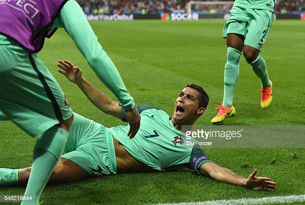 Cristiano Ronaldo of Portugal celebrates scoring the opening goal with his team mates during the UEFA EURO 2016 semi final match between Portugal and...