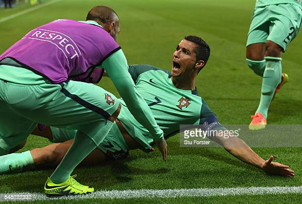 Cristiano Ronaldo of Portugal celebrates scoring the opening goal during the UEFA EURO 2016 semi final match between Portugal and Wales at Stade des...
