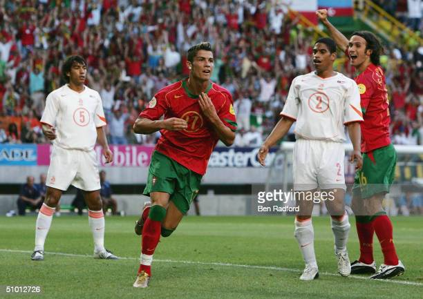 Cristiano Ronaldo of Portugal celebrates scoring their first goal during the UEFA Euro 2004 Semi Final match between Portugal and Holland at the Jose...