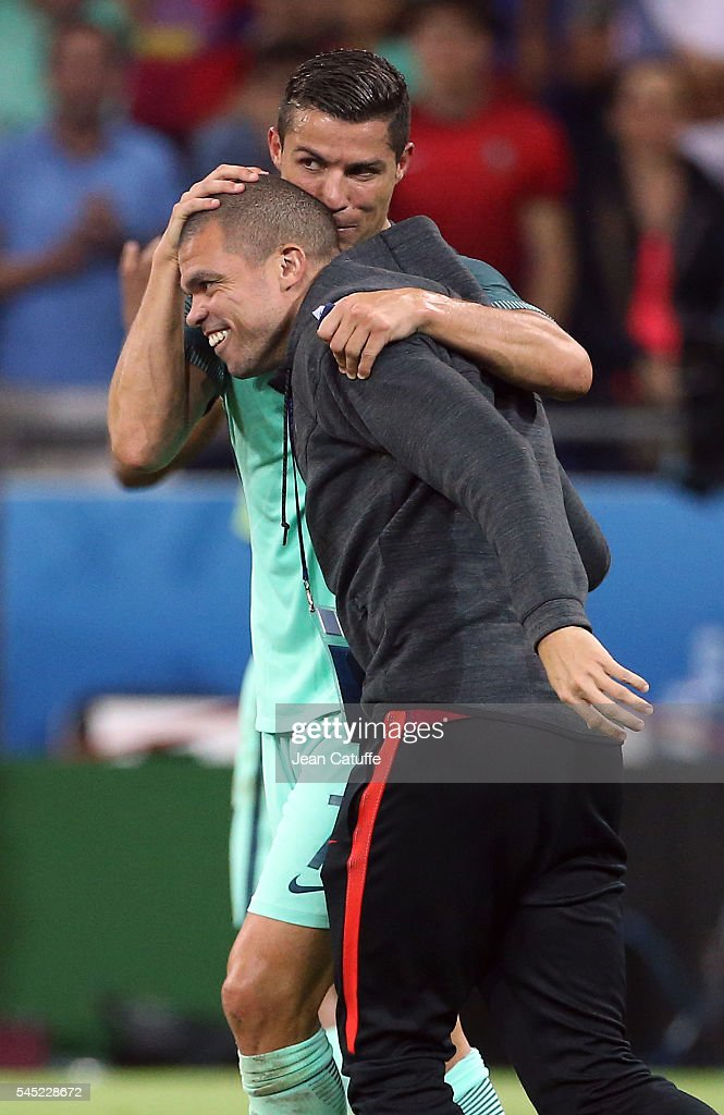 Cristiano Ronaldo of Portugal celebrates the victory with Pepe following the UEFA Euro 2016 semi-final between Wales and Portugal at Parc OL, Stade des Lumieres on July 6, 2016 in Lyon, France.