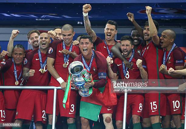 Cristiano Ronaldo of Portugal celebrates the victory with teammates during the trophy ceremony following the UEFA Euro 2016 final match between...