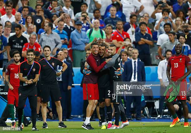 Cristiano Ronaldo of Portugal celebrates winning with his team mates Eduardo and Anthony Lopes at the final whistle during the UEFA EURO 2016 Final...