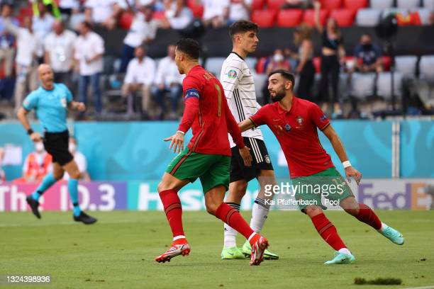 Cristiano Ronaldo of Portugal celebrates with Bruno Fernandes after scoring their side's first goal during the UEFA Euro 2020 Championship Group F...