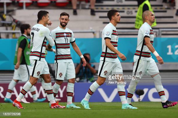 Cristiano Ronaldo of Portugal celebrates with Bruno Fernandes and team mates after scoring their side's second goal during the UEFA Euro 2020...