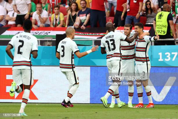 Cristiano Ronaldo of Portugal celebrates with Danilo and team mates after scoring their side's third goal during the UEFA Euro 2020 Championship...