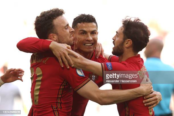 Cristiano Ronaldo of Portugal celebrates with Diogo Jota and Bernardo Silva after scoring their side's first goal during the UEFA Euro 2020...