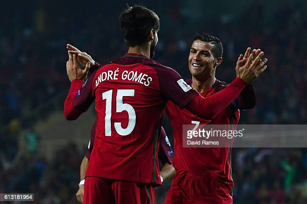 Cristiano Ronaldo of Portugal celebrates with his team mate Andre Gomes after scoring his team's fourth goal during the FIFA 2018 World Cup Qualifier...